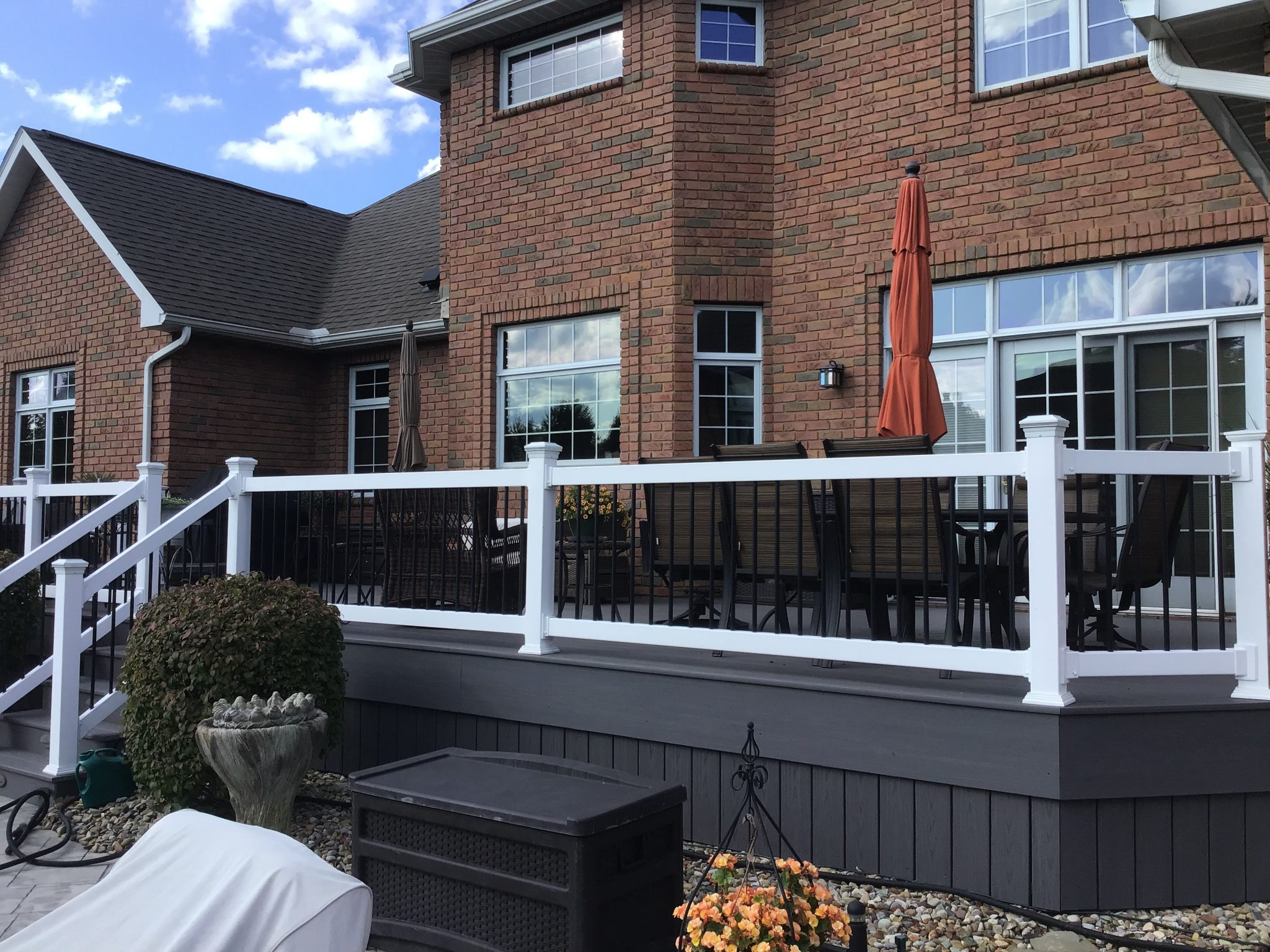 newly installed deck with white and black railing