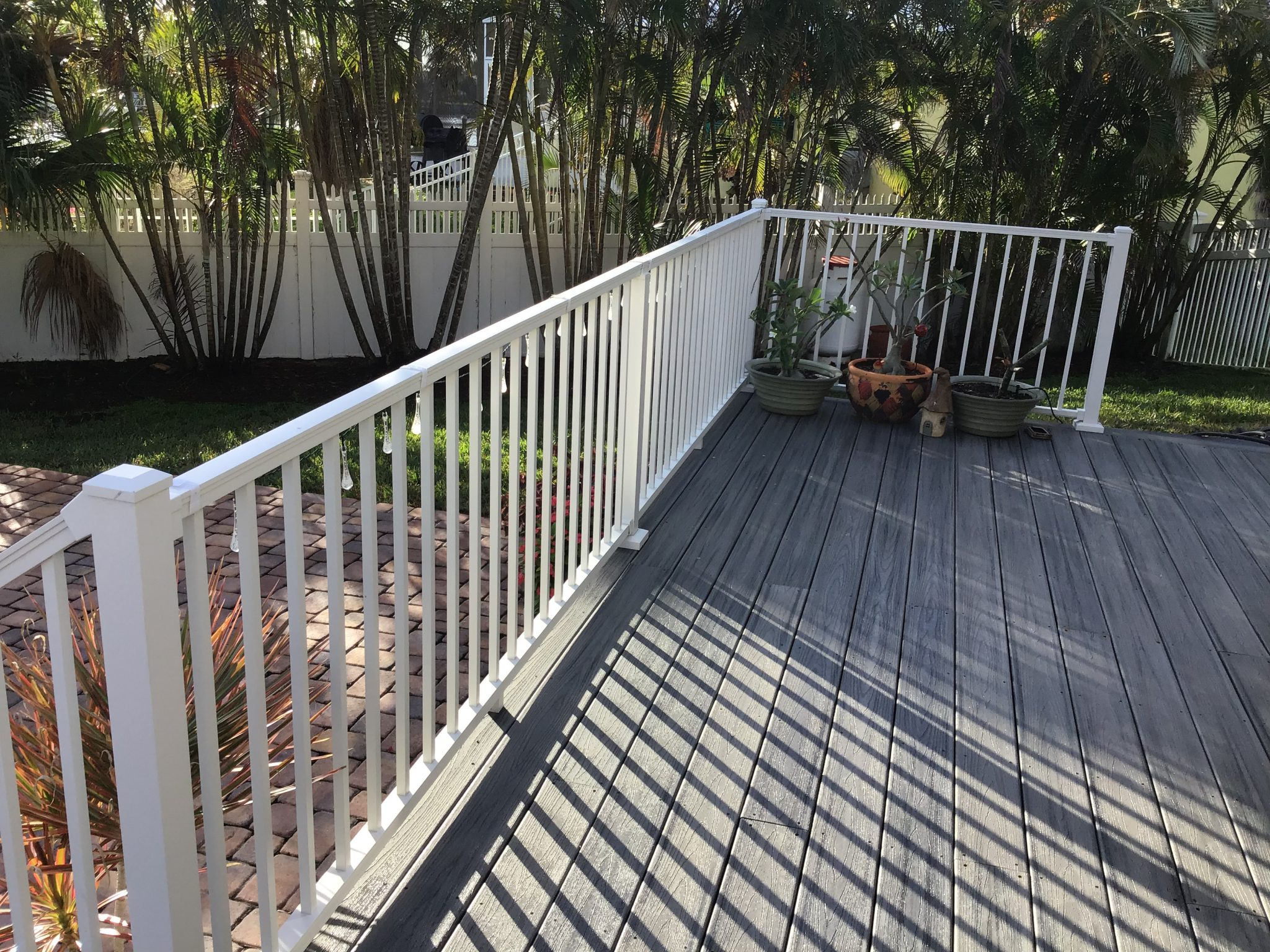 newly installed gray deck with white railing