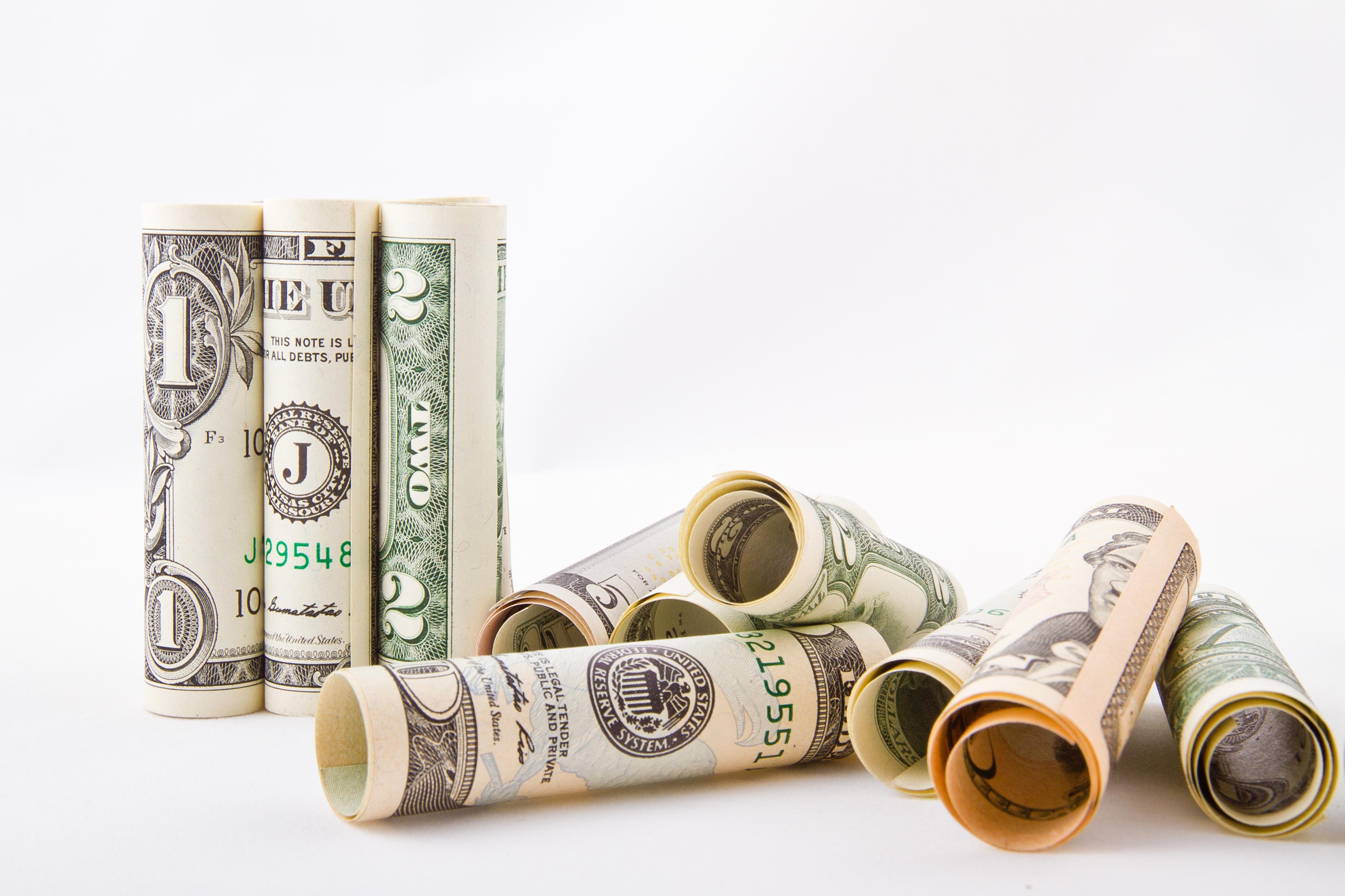 rolled up dollar bills photo