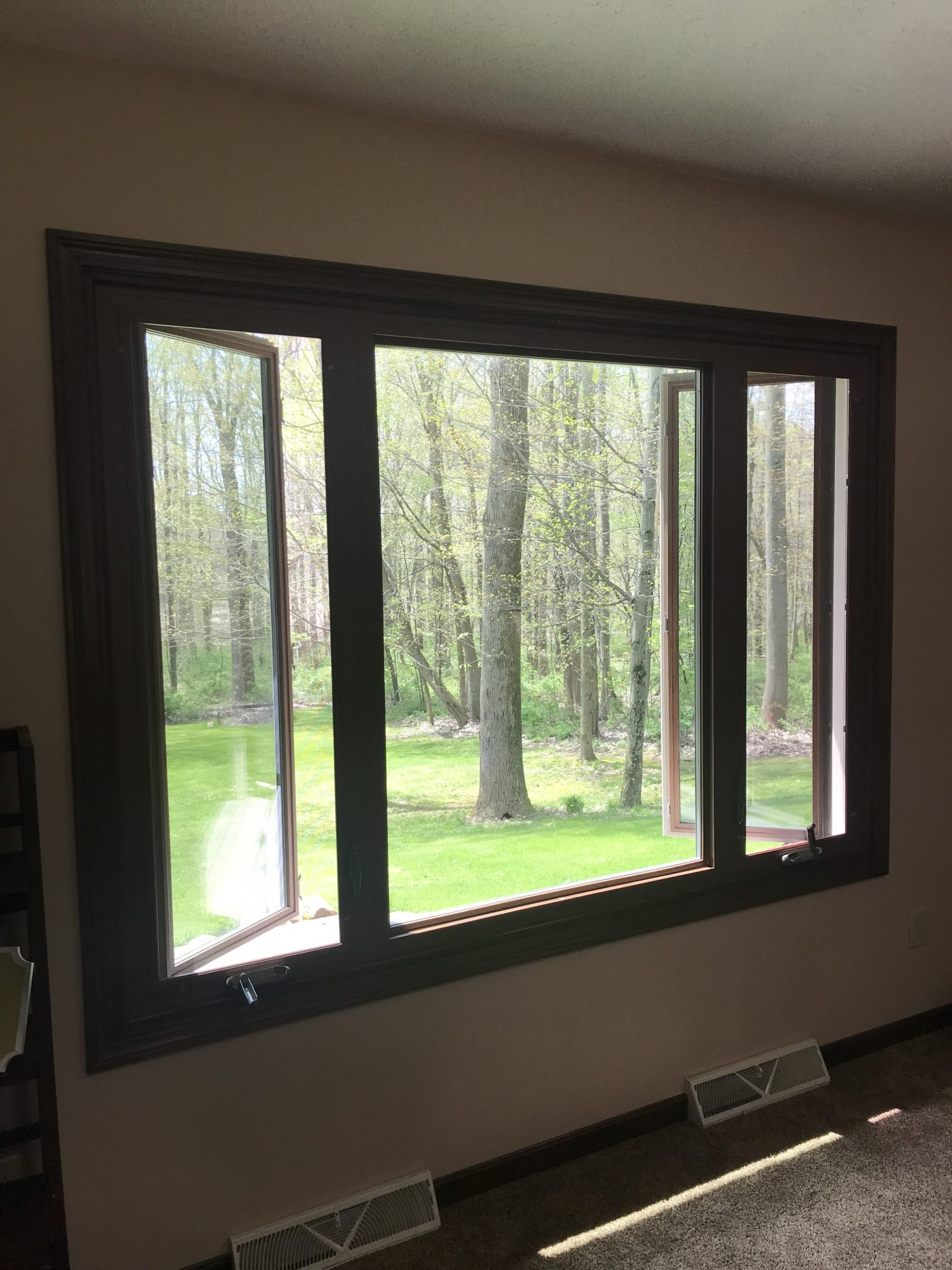 newly installed picture window with casement windows