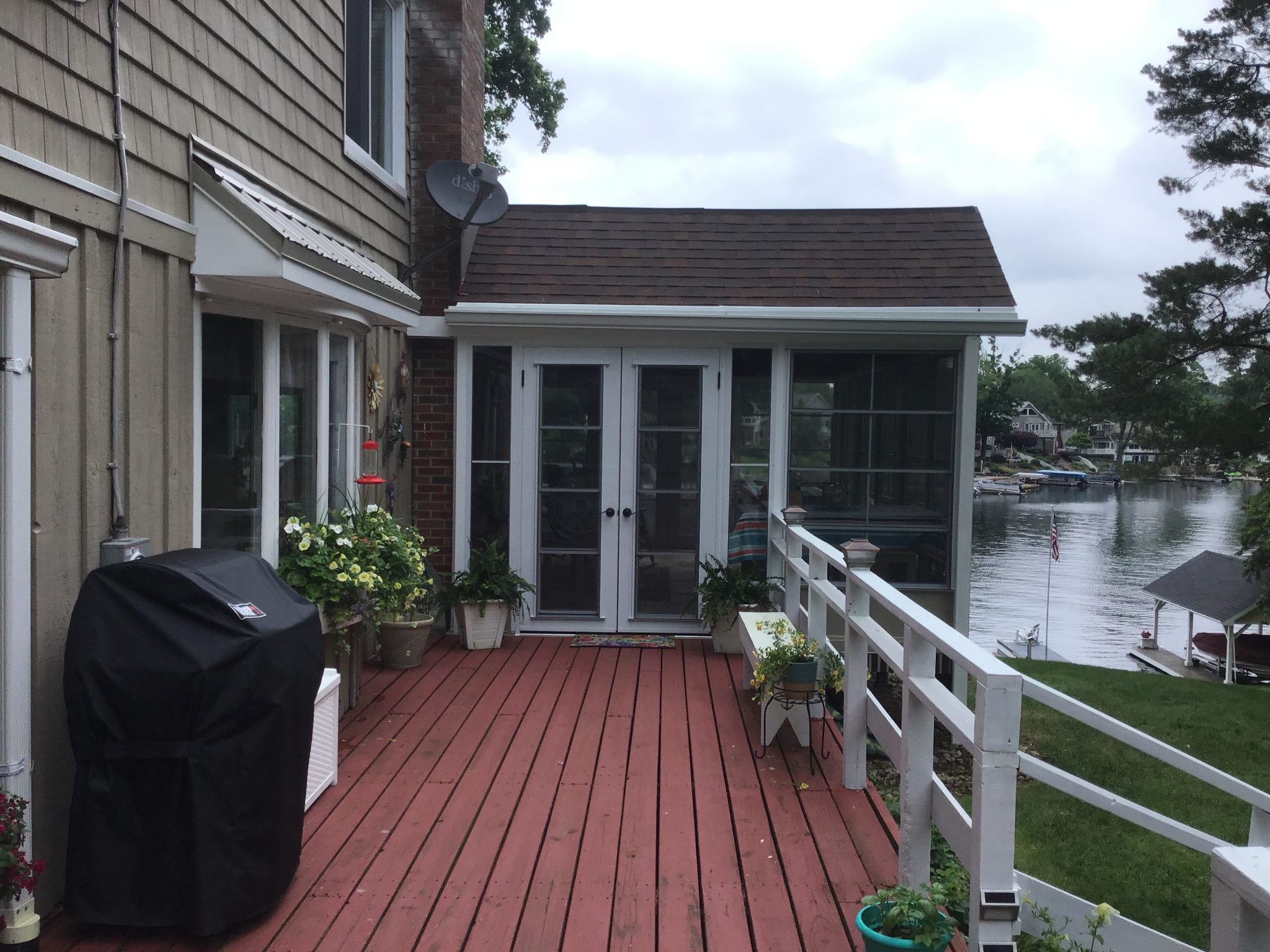 newly installed white railing on red deck