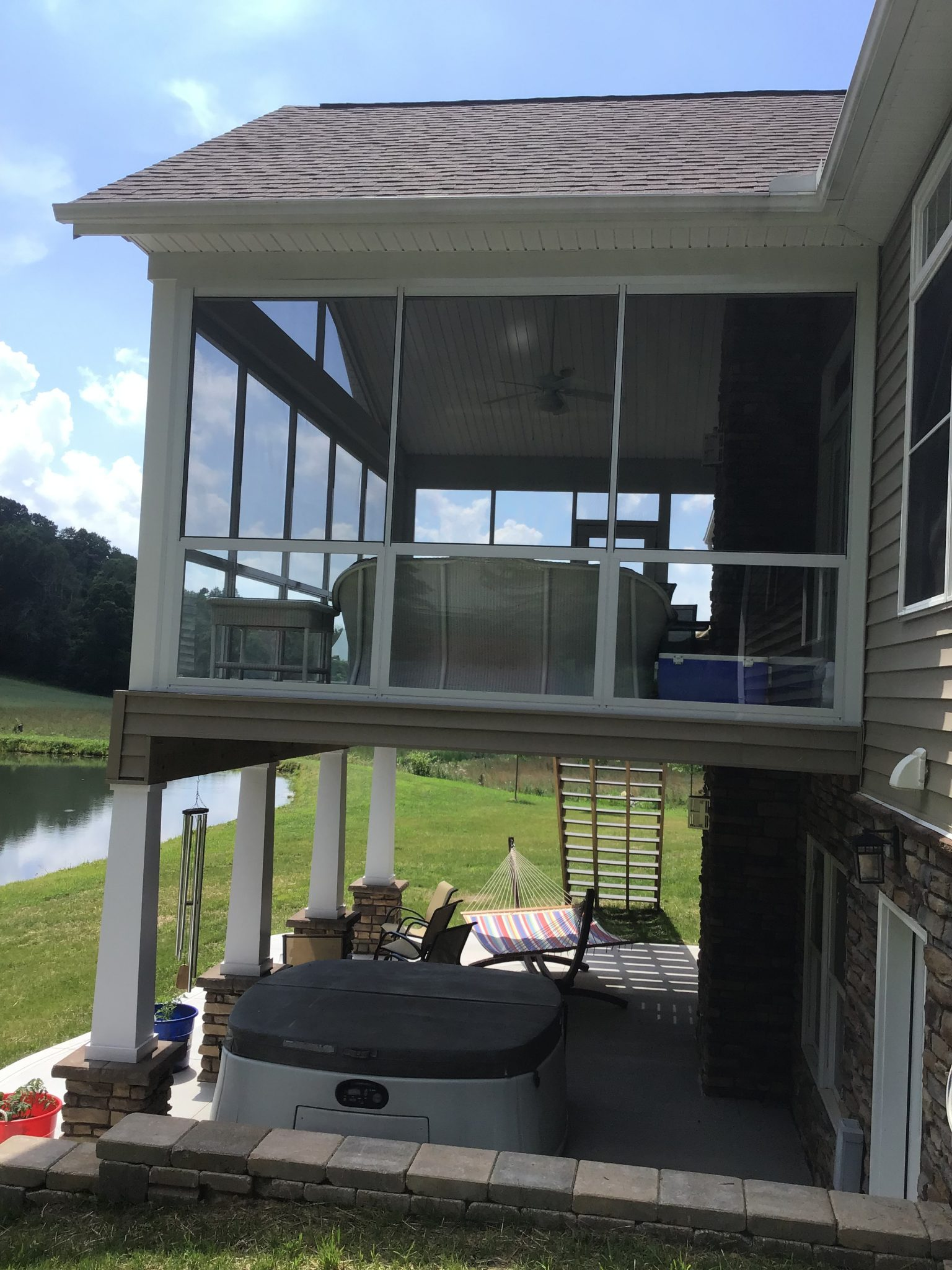 side view of elevated screen room over patio