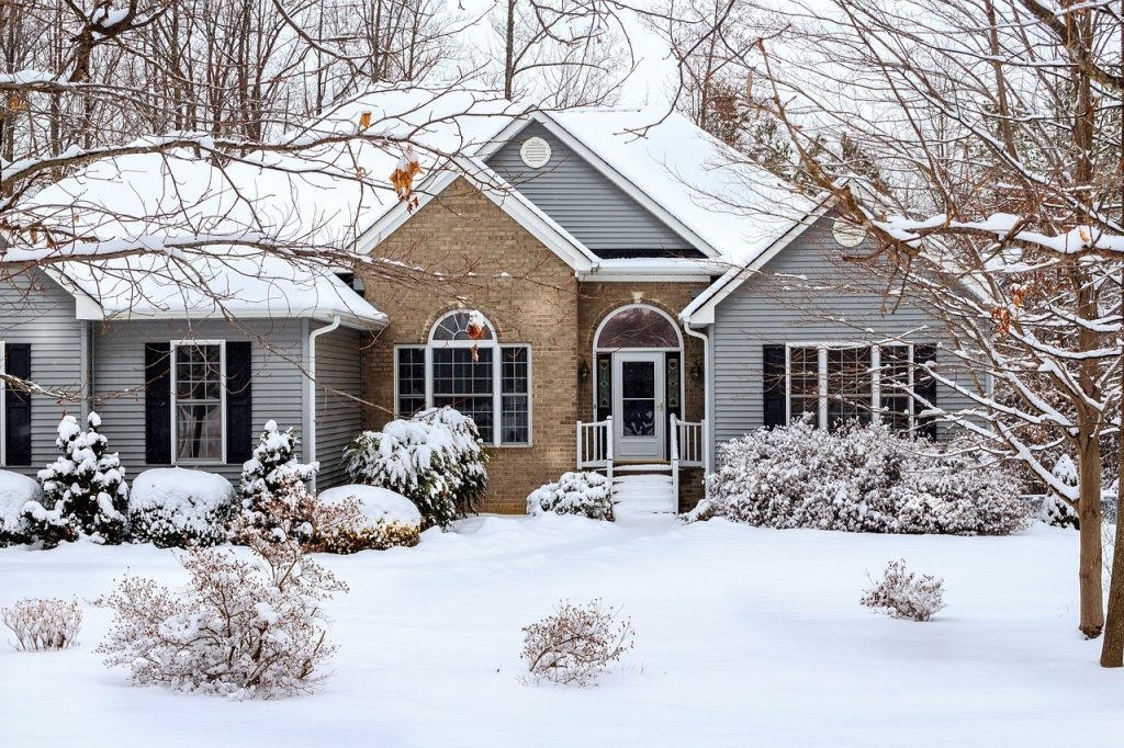 photo of a snow covered home